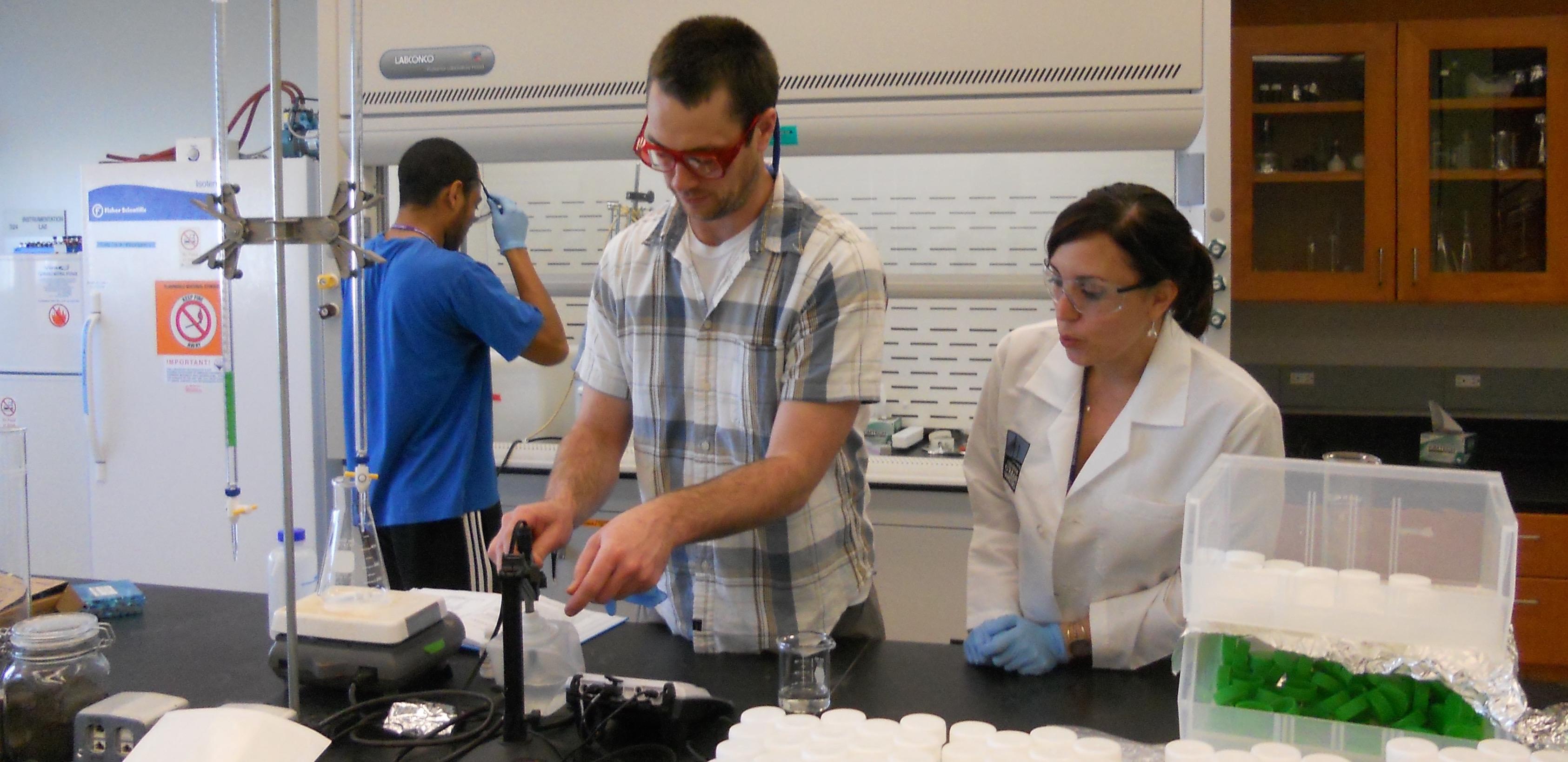 Former postdoctoral researcher Justin Miller-Schulze instructing student assistants